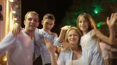 Family smiling at the camera. night on the street. dances, plays the fool Stock Footage