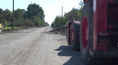 Vehicle on reconstruction asphalt road Stock Footage