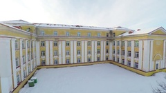 Old soviet school building. Winter city landscape covered with snow. Aerial foot Stock Footage
