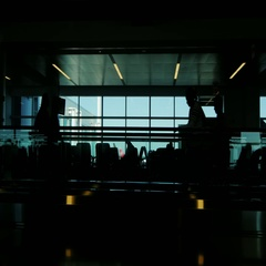Silhouettes of passengers at the airport. A hurry on a plane or sitting in Stock Footage