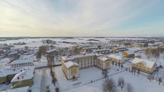 Buildings covered with snow. Small town landscape. Aerial footage. Stock Footage