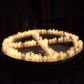 4k Burning church candles on a water filled table in cross formation 4k or 4k+ Resolution