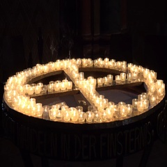 4k Burning church candles on a water filled table in cross formation Stock Footage