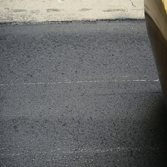 Asphalt paving with a steel wheel roller. Steam coming out from asphalt. Stock Footage