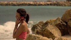 Young, beautiful woman talking on cellphone, super slow motion Stock Footage