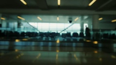 Blurry video - background Airport terminal, passengers are on your flight Stock Footage