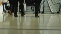 The crowd of passengers with luggage and shopping bags on wheels in a hurry to Stock Footage