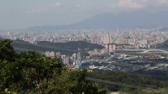 Landscape of Taipei City, there are mountains on the horizon, Panning. Stock Footage
