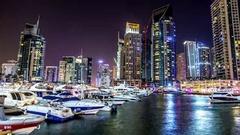 Dubai, UAE : yachts in the popular district of Dubai Marina. Timelapse Stock Footage