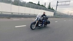 Biker Rides on Classic Motocyle on the Highway Stock Footage
