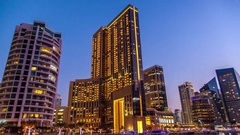 Dubai, UAE:  tower in the district of Dubai Marina. Transition day into night. Stock Footage
