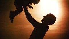 Shadow Figure of Father Playing with Daughter Stock Footage
