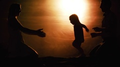 Silhouette of Toddler Running towards Mother Stock Footage