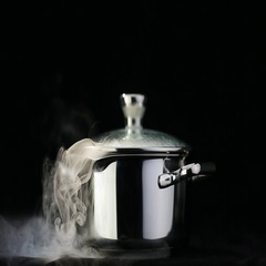 Steam over cooking pot isolated on black background Stock Footage
