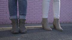 Young Women Stand Side By Side By Pink Wall And Dance (Closeup Of Their Feet) Stock Footage