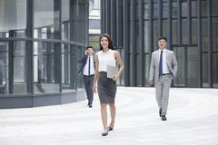 Confident business people walking outdoors Stock Photos