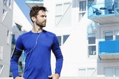 Athletic dude in blue, looking away Stock Photos