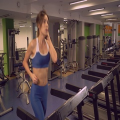 Female warming up before workout in sport club Stock Footage