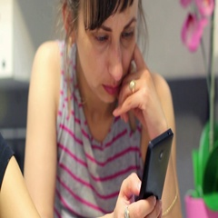 Two women solve the problem on your smartphone, write messages Stock Footage