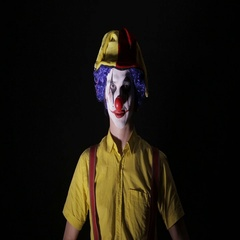 Scary clown making frightening faces. Close-up Stock Footage