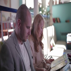 Young couple looking at the menu, choosing dishes Stock Footage