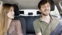 Couple driving car dancing listening radio Arkistovideo