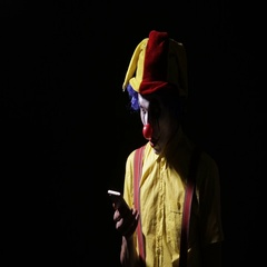 Evil scary clown dials the phone number to scare you Stock Footage