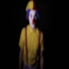 Scary clown screaming into camera faces. Close-up Stock Footage