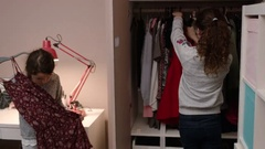 Sisters picking out clothes to wear Stock Footage