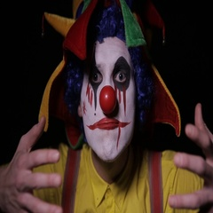 Scary clown uglify his make up. Horror, spooky clown Stock Footage