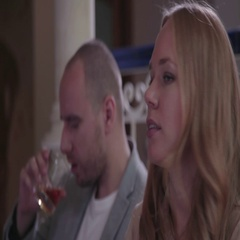 Woman is taking away a glass with alcohol from a man Stock Footage