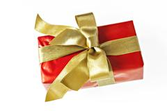 Gift red box with gold ribbon and bow isolated. Stock Photos