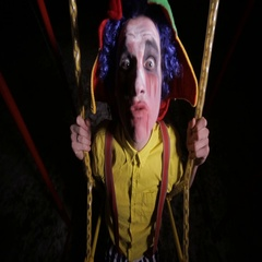 Creepy clown in the street, swinging. Nightmare picture Stock Footage