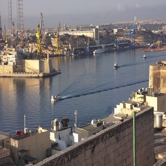 WORK BOATS LEAVING VALLETTA HARBOUR Stock Footage