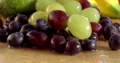 Selection of fresh healthy fruit on a wooden table Stock Footage
