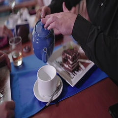 Man pouring black tea in a cup Stock Footage