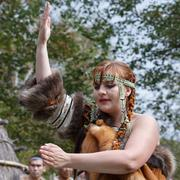 Young woman dancing in clothing aborigine of Kamchatka Stock Photos