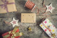 Process of packing holiday gifts Stock Photos