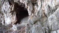 Cave in montains on sea shore Stock Footage