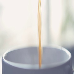 Close up of pouring coffee into white cup Stock Footage