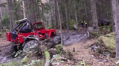 Offroad driving different cars in an extremely muddy forest Stock Footage