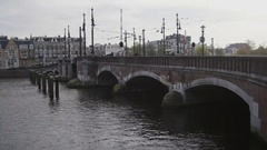 Amsterdam, Netherland, bridge on canal in Amsterdam, Amstel Stock Footage