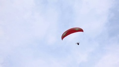 Two Paraglider in Flight Over a Mountain Ridge Summer Day Stock Footage