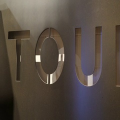 A big TOUR sign on a gray wall of a building Stock Footage