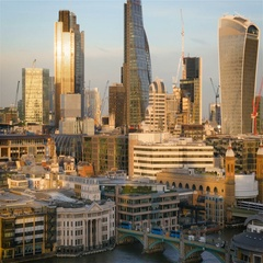 City of London and The River Thames at dusk; zoom out reveal Stock Footage