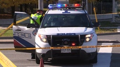 Police cruiser and officers at crime scene Stock Footage