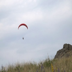 Paraglider Flight Over Grassy Slope Mountain. Summer Day. Stock Footage