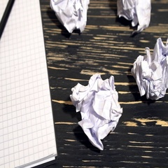 Person throwing a lot of crumpled paper on a desk, close-up. Stock Footage