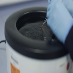 Microtomist Separating Tissue Samples with a Microtome Knife Stock Footage