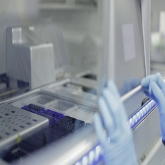 Lab Technician Operating a DNA Sample Extraction Machine Stock Footage